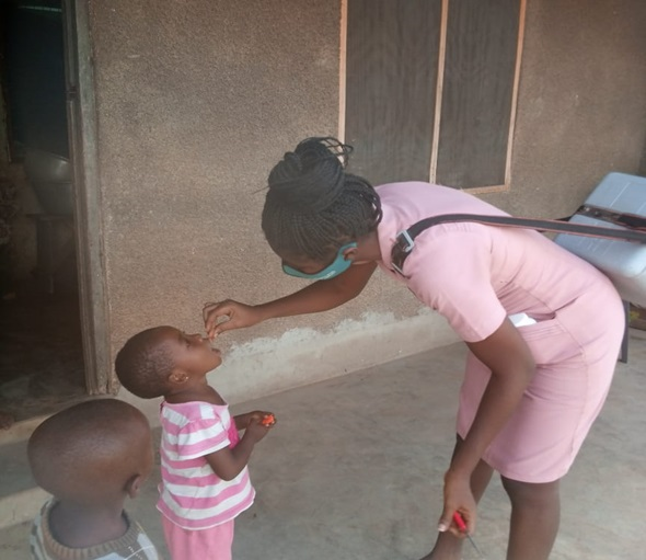 A-child-receiving-vitamin-A-during-home-visit